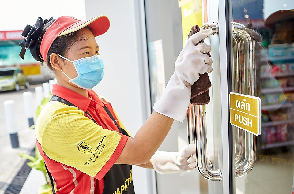 Shell Staff at shell station cleaning glass door