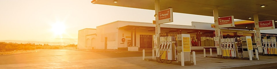 The forecourt of a shell service station at dusk