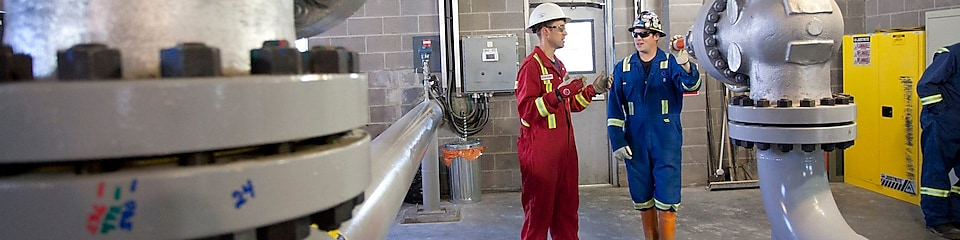Two engineers at the Dawson Creek Reclaimed Water Project facility