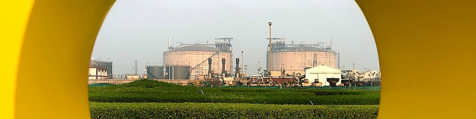 LNG tanks in Hazira, India, surrounded by greenery and fields